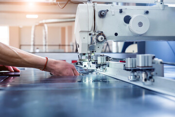 Fabric industry production line. Textile factory. Working tailoring process