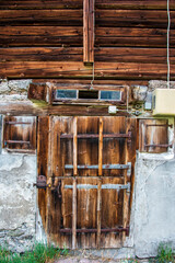 old wood entrance in a house in the Swiss Alps in Glarus