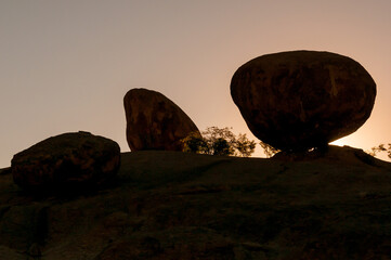 Silhouette of solid granite boulders at sunrise at Ameib