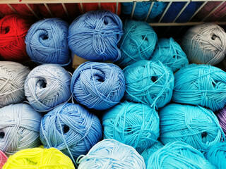 balls of thread for knitting different colors.