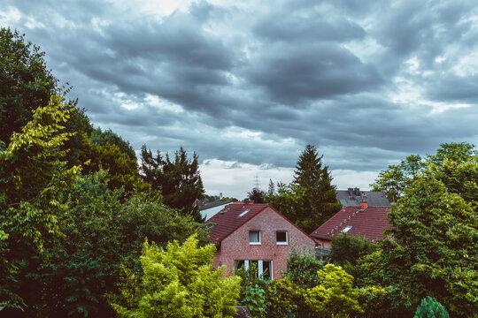 Modern german houses against dramatic sky