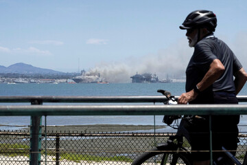 Smoke rises from a fire on board the U.S. Navy amphibious assault ship USS Bonhomme Richard at Naval Base San Diego