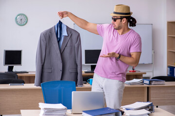 Young male employee preparing for the trip