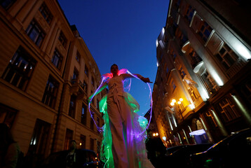 An artist performs during a street theater festival in Prague