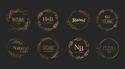 Vector Collection of gold hand drawn floral logo templates with branches and flowers isolated on black background. Elegant design concept with wreaths, frames and borders