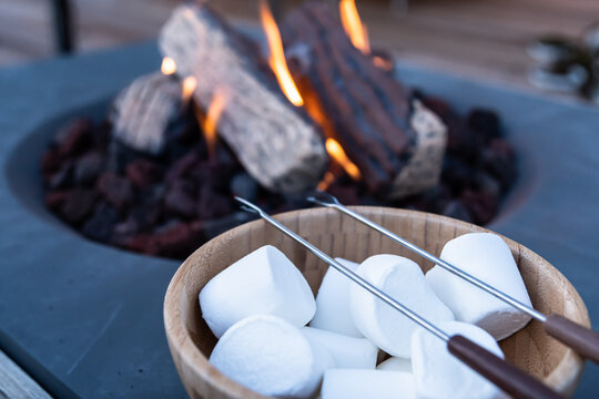 Roasting marshmallow over a gas fire while glamping
