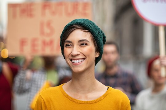 Happy smiling woman in protest for female rights