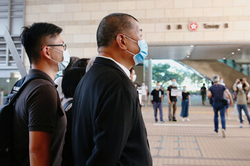 Pro-democracy media tycoon Jimmy Lai arrives at the West Kowloon Courts, in Hong Kong