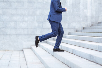 Photo sur Plexiglas Nature Closeup view of entrepreneur running up stairs, being late for work in busy city