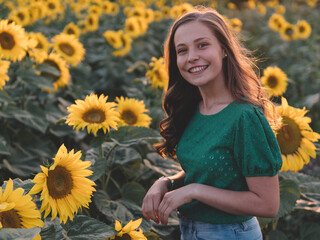 young woman in a sunflower field