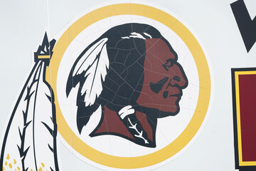 Redskins logo is seen on a vehicle after the team announced they will scrap the name at FedEx Field in Landover, Maryland