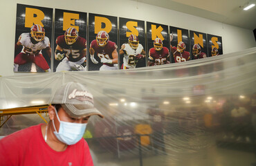 Work is underway at the Washington Redskins official shop at their stadium after the team announced they will scrap the name and logo at FedEx Field in Landover, Marylan