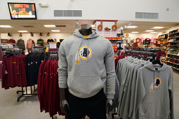 Redskins branded merchandise sits on display at the Washington Redskins official stadium shop after the team announced they will scrap the name and logo at FedEx Field in Landover, Maryland