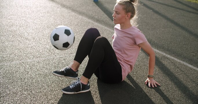 Girl practicing soccer skills and tricks