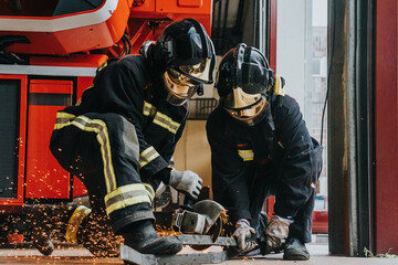 Firefighters using metal grinder during training