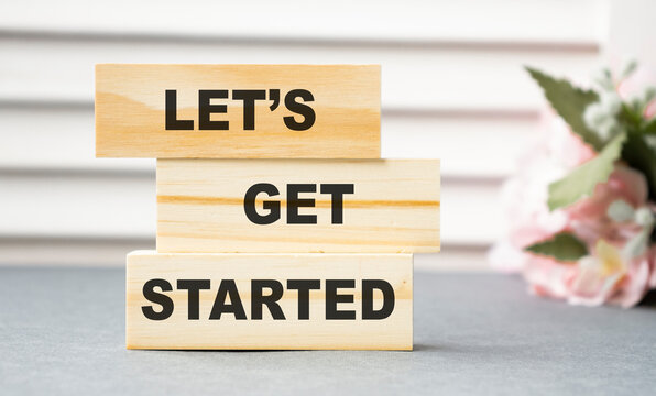 let's get started text on wooden block, business concept
