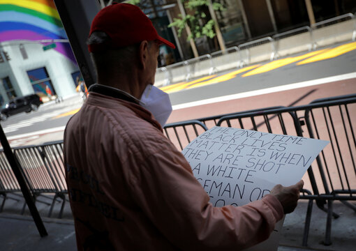 """""""Black Lives Matter"""" mural vandalized with red paint along 5th Avenue outside Trump Tower in New York City"""