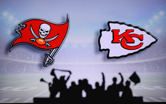 Tampa Bay Buccaneers vs. Kansas City Chiefs . Fans support on NFL Game. Silhouette of supporters, big screen with two rivals in background.