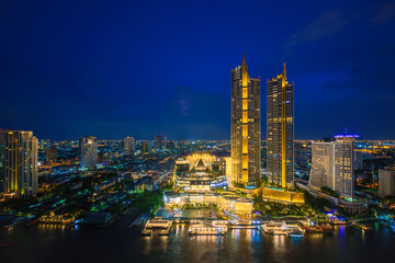 perspective night scenery of Iconsiam is a mixed-use development on Chao Phraya River banks in Bangkok, It includes one of the largest shopping malls in Asia and Magnolias hotels and residences