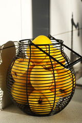 Yellow golden delicious apples in wire basket