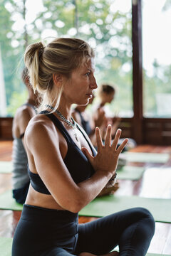 People meditating together in a yoga class.