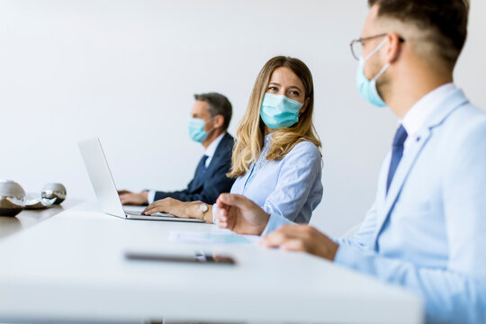 Group of business people have a meeting and working in office and wear masks as protection from corona virus