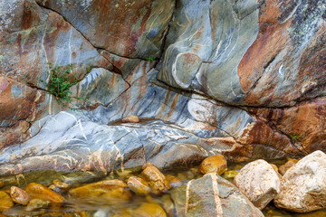 Photo sur Toile Les Textures Color and shapes of the rock eroded by the passage of water. Truchillas River, Sierra de la Cabrera, León, Spain.