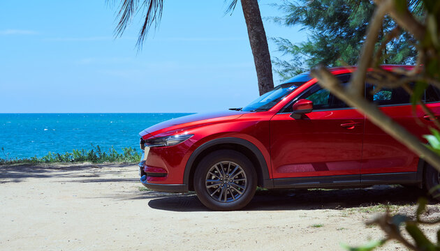 Kuala Lumpur, Malaysia - July 11, 2019 : New red Mazda CX 5  crossover SUV park at beach side . Mazda CX 5  is one of Malaysian favorite SUV car .