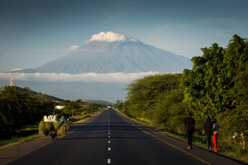 Tuinposter Donkergrijs A road with Mount Meru in background, Tanzania.
