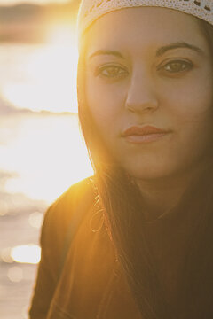 young woman with sun reflections behind