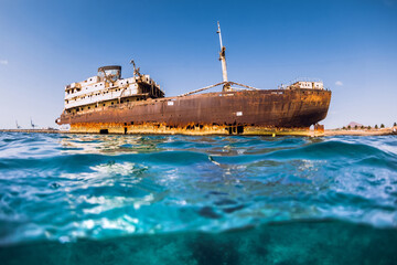 Tuinposter Schipbreuk Old wreck ship in blue ocean at Lanzarote