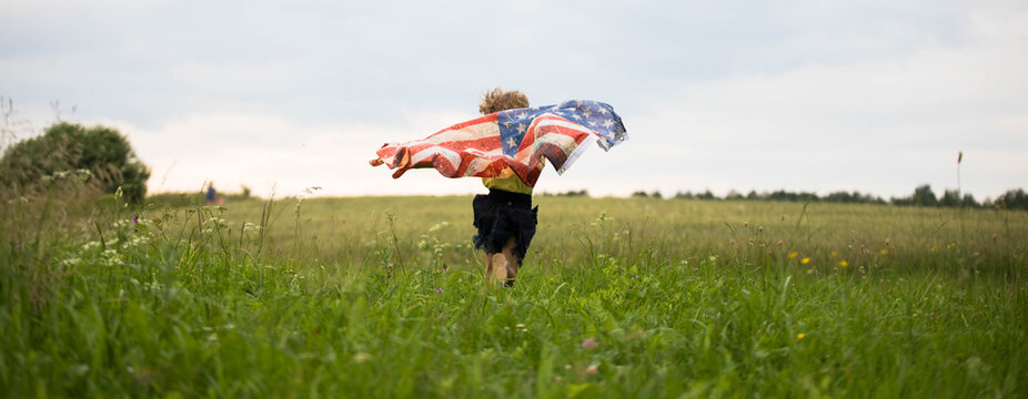 Patriotic holiday. Happy kid, cute little child girl with American flag.