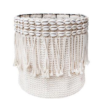 woven laundry basket isolated on white background . Details of modern boho bohemian style