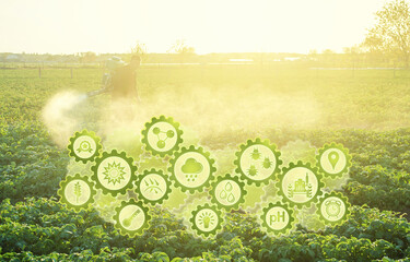 Futuristic innovative technology gears and a farmer processing a potato plantation with a sprayer. Protection from insect pests and fungal diseases. Plant rescue. Agriculture and agribusiness
