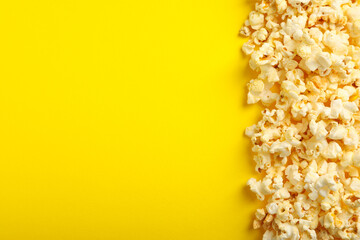 Tasty popcorn on yellow background. Food for watching cinema
