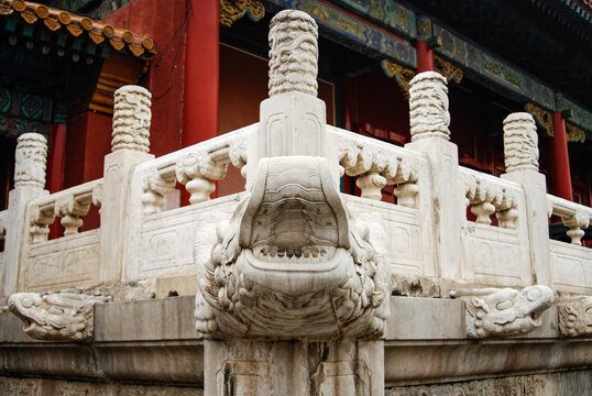 A view on Chinese white marble ornaments and artistic details knowns as dragon scupper in the Forbidden City in Beijing, characteristic for Chinese architecture.