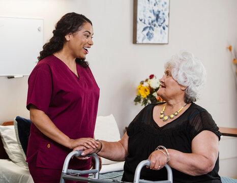 Nurse talking to senior woman in nursing home