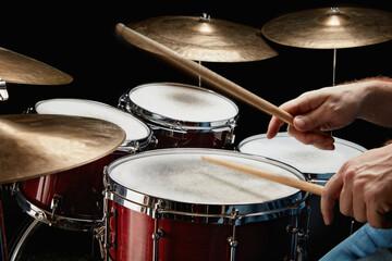 Drummer hands above drum set