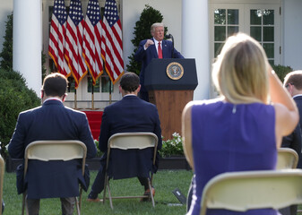 U.S. President Donald Trump attends a news conference in the Rose Garden at the White House in Washington