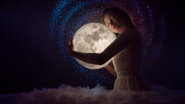 Sensitivity and the universe, astrology and space, a girl holding the moon in her hands, fairy tale photography, night magic