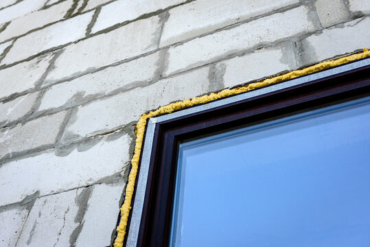 Construction foam sealed the gap between the plastic window and the block wall.