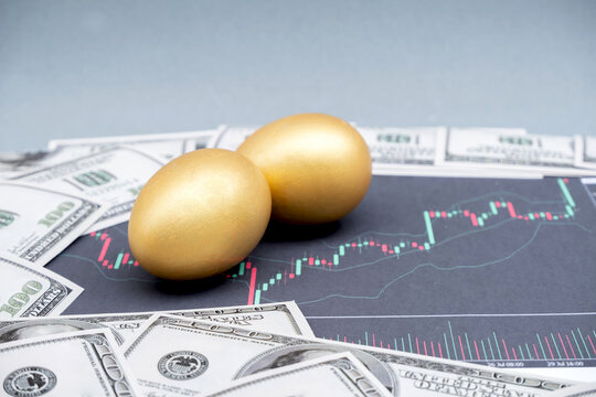 The bank dollar along with the golden egg and stock graph, ideas for financial growth and business success strategies