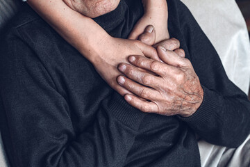 Daughter supports and takes care of her elderly father. caring for the elderly concept