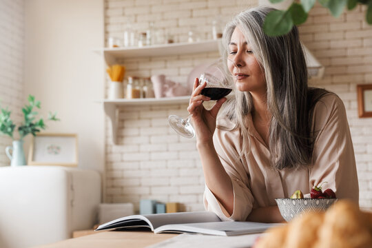 Amazing pretty woman drinking wine
