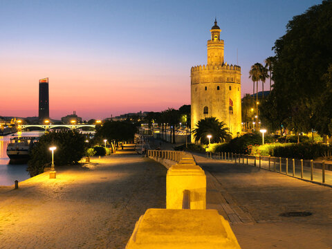 View of Golden Tower (Torre del Oro) of Seville, Andalusia, Spain by river Guadalquivir at sunset