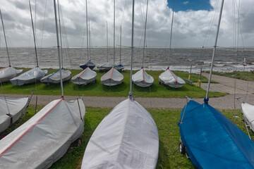 Grounded optimist dinghys in stormy weather, Hjerting, Esbjerg, Denmark