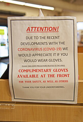 Due to the Covid-19 pandemic, a sign in a store in Arizona requires customers to wear gloves if they wish to handle the merchandise.