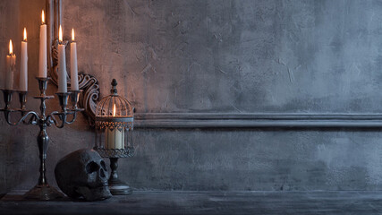 Fototapeta Mystical Halloween still-life background. Skull, candlestick with candles, old fireplace. Horror and witchery. obraz