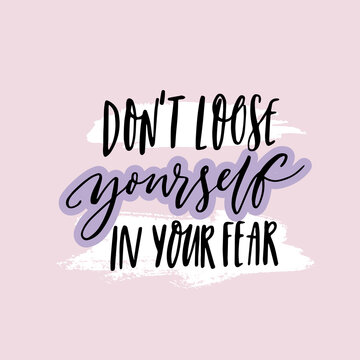 Don't loose yourself in your fear. Inspirational quote about anxiety. Positive motivational saying. Handwritten text on purple background.