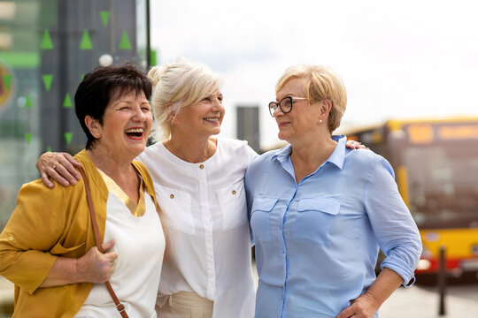 Three senior female friends having good time together